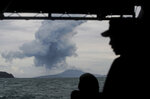 FILE - In this Dec. 28, 2018, file photo, Indonesian Navy personnel watch as Mount Anak Krakatau spews volcanic materials during an eruption in the waters of Sunda Strait. (AP Photo/Fauzy Chaniago, File)