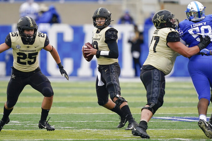 Vanderbilt quarterback Ken Seals (8) scrambles with the ball during the second half of an NCAA college football game against Kentucky, Saturday, Nov. 14, 2020, in Lexington, Ky. (AP Photo/Bryan Woolston)