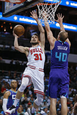 Chicago Bulls guard Tomas Satoransky, left, shoots against Charlotte Hornets forward Cody Zeller during the first half of an NBA basketball game in Charlotte, N.C., Wednesday, Oct. 23, 2019. (AP Photo/Nell Redmond)