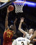 Southern California's Victor Uyaelunmo (34) shoots against California's Connor Vanover, right, in the first half of an NCAA college basketball game Saturday, Feb. 16, 2019, in Berkeley, Calif. (AP Photo/Ben Margot)