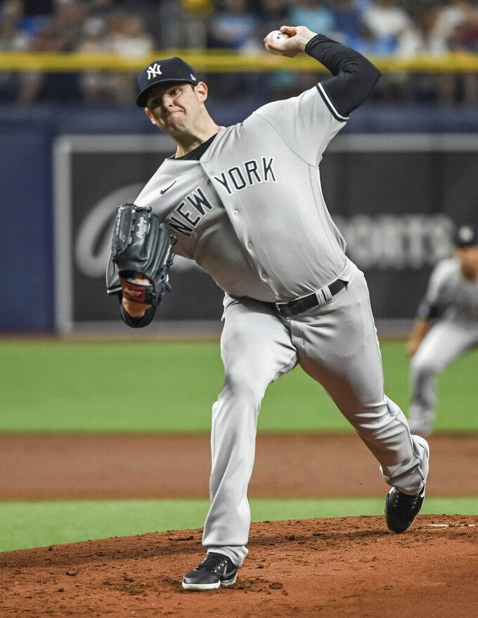 New York Yankees starter Jordan Montgomery pitches to a Tampa Bay Rays batter during the first inning of a baseball game Tuesday, July 27, 2021, in St. Petersburg, Fla. (AP Photo/Steve Nesius)
