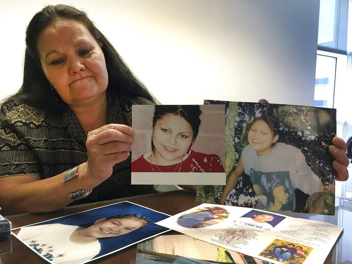 Roberta Tortice holds up photos of her daughter, Katherine