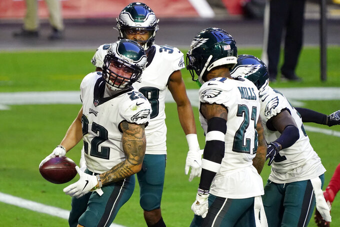 Philadelphia Eagles safety Marcus Epps (22) celebrates his interception against the Arizona Cardinals with teammates during the second half of an NFL football game, Sunday, Dec. 20, 2020, in Glendale, Ariz. (AP Photo/Rick Scuteri)