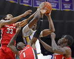LSU forward Kavell Bigby-Williams goes for a rebound along with Georgia's Nicolas Claxton (33), Teshaun Hightower (1) and Jordan Harris (2) in the first half of an NCAA college basketball game, Wednesday, Jan. 23, 2019, in Baton Rouge, La. (AP Photo/Bill Feig)
