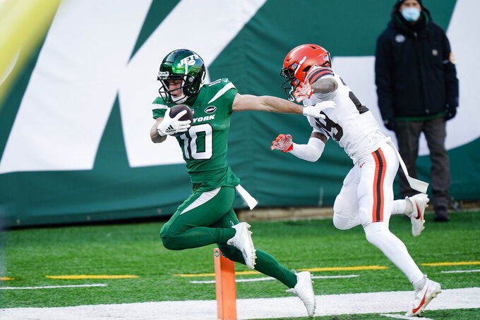 New York Jets' Braxton Berrios (10) runs away from Cleveland Browns' Sheldrick Redwine (29) for a touchdown during the first half of an NFL football game Sunday, Dec. 27, 2020, in East Rutherford, N.J. (AP Photo/Corey Sipkin)