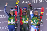 From left, second place Italy's Federica Brignone, winner United States' Mikaela Shiffrin and third place Switzerland's Joana Haehlen celebrate on the podium after an alpine ski, women's World Cup downhill, in Bansko, Bulgaria, Friday, Jan. 24, 2020. (AP Photo/Giovanni Auletta)