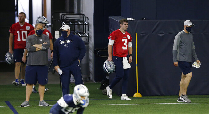 Dallas Cowboys quarterbacks coach Doug Nussmeier, Dallas Cowboys quarterback Garrett Gilbert (3) lead the way as Dallas Cowboys quarterback Ben DiNucci (7) and Dallas Cowboys quarterback Cooper Rush (10) make their way onto the field during NFL football practice in Frisco, Texas, Wednesday, Nov. 4, 2020. (Vernon Bryant/The Dallas Morning News via AP)