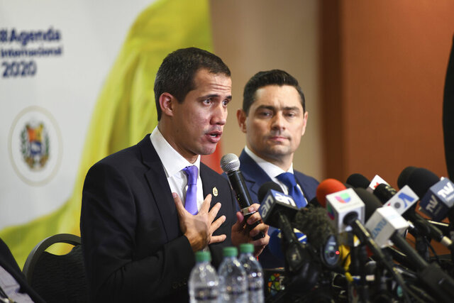 """Venezuela's interim President Juan Guaido speaks to the media after a rally in Miami, Saturday, Feb. 1, 2020. Guaido told a large crowd of cheering expatriates in Miami on Saturday that he will soon make his return to Caracas from an international tour with the """"world's backing"""" to oust President Nicolás Maduro. (AP Photo/Gaston De Cardenas)"""