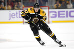 FILE - In this Oct. 29, 2019, file photo, Boston Bruins' Torey Krug is shown during the second period of an NHL hockey game against the San Jose Sharks, in Boston. The NHL is embarking on a free agent period like never before in hockey history. Defensemen Alex Pietrangelo and Torey Krug and winger Taylor Hall headline a talented free agent class. (AP Photo/Winslow Townson, FIle)