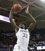 Washington's Isaiah Stewart shoots against Washington State during the first half of an NCAA college basketball game Friday, Feb. 28, 2020, in Seattle. (AP Photo/Elaine Thompson)
