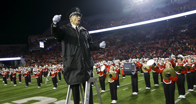 University of Wisconsin-Madison Marching Band Director Mike Leckrone directs the band after an NCAA college football game Saturday, Nov. 24, 2018, in Madison, Wis. Leckrone is retiring after 50 years of directing the UW band. Minnesota beat Wisconsin 37-15. (AP Photo/Andy Manis)