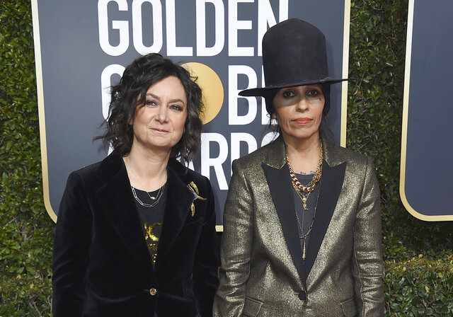 FILE - In this Jan. 6, 2019, file photo, Sara Gilbert, left, and Linda Perry arrive at the 76th annual Golden Globe Awards at the Beverly Hilton Hotel in Beverly Hills, Calif. Gilbert filed for legal separation from her wife of five years, singer and songwriter Perry on Friday, Dec. 27. (Photo by Jordan Strauss/Invision/AP, File)