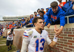 Florida quarterback Feleipe Franks (13) gets congratulated by fans after defeating Florida State 41-14 in an NCAA college football game in Tallahassee, Fla., Saturday, Nov. 24, 2018. (AP Photo/Mark Wallheiser)
