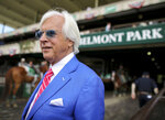 Trainer Bob Baffert walks out to the winner's circle after the Brooklyn Invitational Stakes horse race at Belmont Park, Saturday, June 9, 2018, in Elmont, N.Y. Hoppertunity, trained by Baffert, won the race. (AP Photo/Mary Altaffer)
