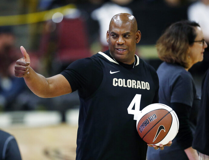 FILE - In this Thursday, March 7, 2019, file photograph, Colorado head football coach Mel Tucker gestures to fans in the first half of an NCAA college basketball game as Colorado hosts UCLA in Boulder, Colo. Colorado's new head coach isn't cutting the Buffaloes any slack in his first season in Boulder, proclaiming,
