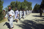 Prisoners are released from Bagram Prison in Parwan province, Afghanistan, Tuesday, May 26, 2020. The Afghan government freed hundreds of prisoners, its single largest prisoner release since the U.S. and the Taliban signed a peace deal earlier this year that spells out an exchange of detainees between the warring sides. (AP Photo/ Rahmat Gul)
