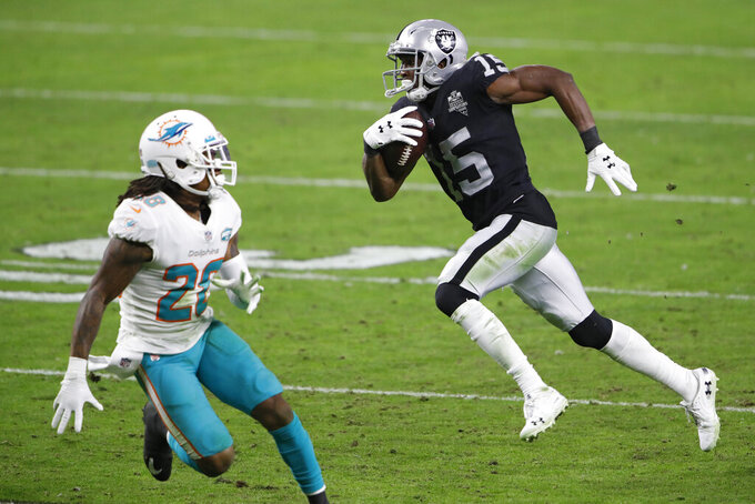 Las Vegas Raiders wide receiver Nelson Agholor (15) runs to score a touchdown against Miami Dolphins strong safety Bobby McCain (28) during the second half of an NFL football game, Saturday, Dec. 26, 2020, in Las Vegas. (AP Photo/Steve Marcus)