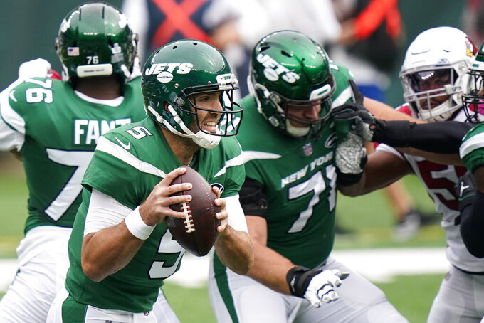 New York Jets quarterback Joe Flacco (5) looks to pass on the run during the first half of an NFL football game against the Arizona Cardinals, Sunday, Oct. 11, 2020, in East Rutherford. (AP Photo/Frank Franklin II)
