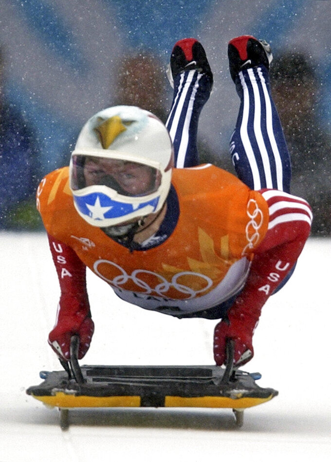 FILE - In this Feb. 20, 2002, file photo, Jimmy Shea of the United States pushes off during the men's skeleton final at the 2002 Salt Lake City Winter Olympics on his way to winning a gold medal in Park City, Utah. Shea has been charged with sexual abuse of a child in Utah. He made his first court appearance Monday, March 29, 2021, on one count of aggravated sexual abuse of a child and two counts of sexual battery. The alleged abuse occurred in 2020, court documents show. (AP Photo/Elise Amendola, File)