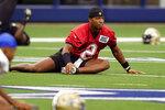 New Orleans Saints quarterback Jameis Winston (2) stretches with teammates during NFL football practice in Arlington, Texas, Tuesday, Aug. 31, 2021. (AP Photo/LM Otero)