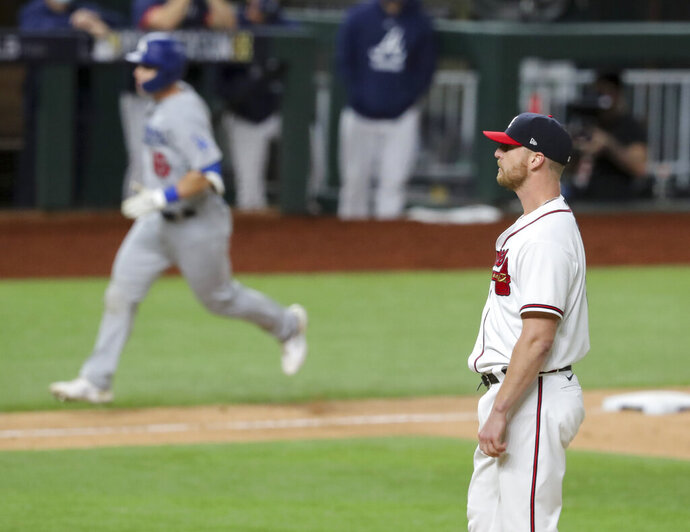Atlanta Braves relief pitcher Will Smith, right, reacts after giving up a three-run home run to Los Angeles Dodgers catcher Will Smith, back left, in the sixth inning in Game 5 of a baseball National League Championship Series, Friday, Oct. 16, 2020, in Arlington, Texas. (Curtis Compton/Atlanta Journal-Constitution via AP)/Atlanta Journal-Constitution via AP)