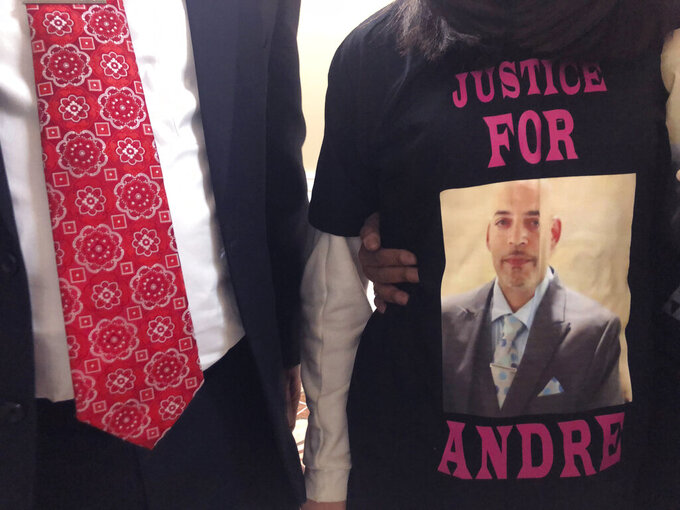 """Andre Hill, fatally shot by Columbus police on Dec. 22, is memorialized on a shirt worn by his daughter, Karissa Hill, on Thursday, Dec. 31, 2020, in Columbus, Ohio. Karissa Hill said she considered her father an """"everything man"""" because he did so many things. (AP Photo/Andrew Welsh-Huggins)"""