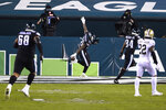 Philadelphia Eagles' Miles Sanders (26) celebrates after scoring a touchdown during the first half of an NFL football game against the New Orleans Saints, Sunday, Dec. 13, 2020, in Philadelphia. (AP Photo/Derik Hamilton)