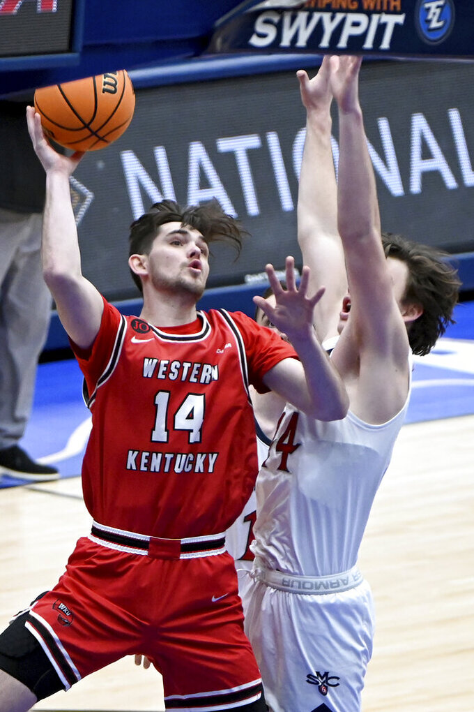 Western Kentucky guard Luke Frampton (14) drives to the basket on St. Mary's guard Alex Ducas (44) in the first half of an NCAA college basketball game in the first round of the NIT, Wednesday, March 17, 2021, in Frisco, Texas. (AP Photo/Matt Strasen)