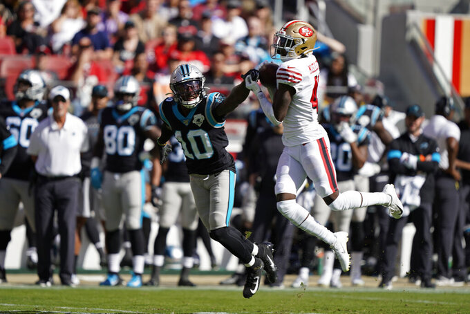 San Francisco 49ers defensive back Emmanuel Moseley intercepts a pass intended for Carolina Panthers wide receiver Curtis Samuel (10) during the first half of an NFL football game in Santa Clara, Calif., Sunday, Oct. 27, 2019. (AP Photo/Tony Avelar)