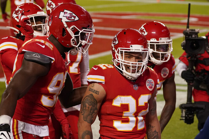 Kansas City Chiefs strong safety Tyrann Mathieu (32) reacts after his interception against the Denver Broncos in the first half of an NFL football game in Kansas City, Mo., Sunday, Dec. 6, 2020. (AP Photo/Charlie Riedel)