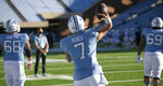 "North Carolina quarterback Sam Howell (7) has replaced his last name with 'Peace"" on the back of his game jersey as he warms up for the Tar Heels' game against Notre Dame on Saturday, November 27, 2020 at Kenan Stadium in Chapel Hill, N.C. Several players has done the same, choosing other messages for this particular game. (Robert Willett/The News & Observer via AP)"