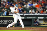 Houston Astros' Jake Meyers hits a three-run home run against the Seattle Mariners during the second inning of a baseball game Monday, Sept. 6, 2021, in Houston. (AP Photo/David J. Phillip)