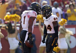 Arizona State's N'Keal Harry (1) celebrates his touchdown catch with teammate Frank Darby during the first half of an NCAA college football game against Southern California Saturday, Oct. 27, 2018, in Los Angeles. (AP Photo/Marcio Jose Sanchez)