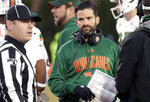 Miami head coach Manny Diaz looks to an official during the second quarter of an NCAA college football game against Duke in Durham, N.C., Saturday, Nov. 30, 2019. (AP Photo/Chris Seward)