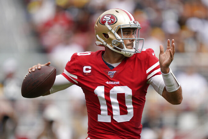 San Francisco 49ers quarterback Jimmy Garoppolo (10) passes against the Pittsburgh Steelers during the first half of an NFL football game in Santa Clara, Calif., Sunday, Sept. 22, 2019. (AP Photo/Tony Avelar)