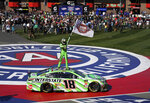 Kyle Buschs stands on his car after winning the NASCAR Cup Series auto race at Auto Club Speedway in Fontana, Calif., Sunday, March 17, 2019. The win was the 200th for Busch across NASCAR's three national series. (AP Photo/Rachel Luna)