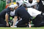 New York Jets' Mike White is injured during the second half of a preseason NFL football game against the Green Bay Packers Saturday, Aug. 21, 2021, in Green Bay, Wis. (AP Photo/Matt Ludtke)