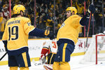 Nashville Predators left wing Austin Watson (51) celebrates with center Calle Jarnkrok (19), of Sweden, after Jarnkrok scored a goal against the Calgary Flames during the second period of an NHL hockey game Thursday, Oct. 31, 2019, in Nashville, Tenn. (AP Photo/Mark Zaleski)