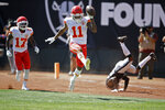Kansas City Chiefs wide receiver Demarcus Robinson (11) celebrates after scoring a touchdown as teammate Mecole Hardman (17) looks on during the first half of an NFL football game against the Oakland Raiders Sunday, Sept. 15, 2019, in Oakland, Calif. At right is Oakland Raiders cornerback Gareon Conley. (AP Photo/Ben Margot)