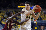 Michigan forward C.J. Baird (24) is defended by Elon guard Kris Wooten (10) during the second half of an NCAA college basketball game Friday, Nov. 15, 2019, in Ann Arbor, Mich. (AP Photo/Carlos Osorio)
