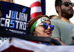 Supporters for 2020 Democratic presidential candidate Julian Castro join others during a rally in San Antonio, Wednesday, April 10, 2019. (AP Photo/Eric Gay)