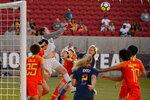 China goalkeeper Peng Shimeng knocks the ball away during the team's international friendly soccer match against the United States in Sandy, Utah, Thursday, June 7, 2018. (Trent Nelson/The Salt Lake Tribune via AP)