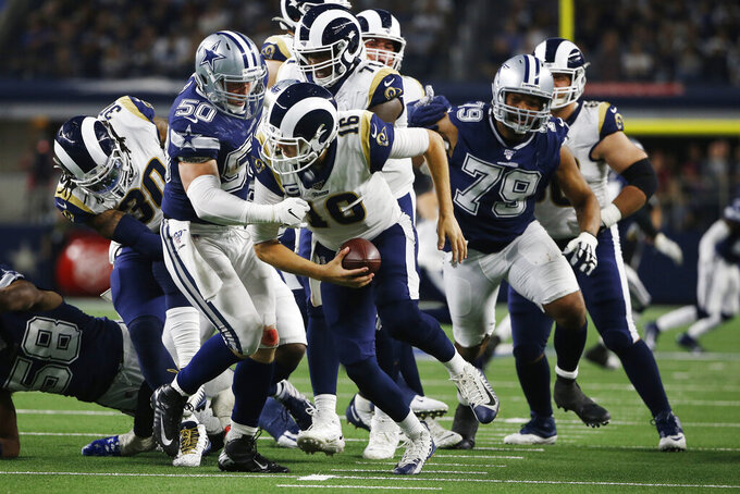 Dallas Cowboys outside linebacker Sean Lee (50) moves in to tackle Los Angeles Rams quarterback Jared Goff (16) in the second half of an NFL football game in Arlington, Texas, Sunday, Dec. 15, 2019. (AP Photo/Ron Jenkins)