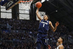 Georgetown forward Jamorko Pickett (1) goes up for a dunk in front of Butler forward Jordan Tucker (1) in the second half of an NCAA college basketball game in Indianapolis, Saturday, Feb. 15, 2020. Georgetown defeated Butler 73-66. (AP Photo/Michael Conroy)