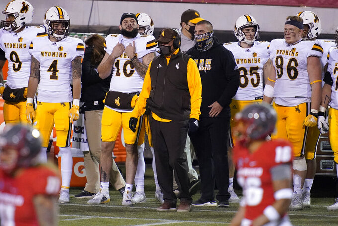 Wyoming head coach Craig Bohl watches from the sideline during the second half of an NCAA college football game against New Mexico, Saturday, Dec. 5, 2020, in Las Vegas. (AP Photo/John Locher)
