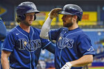 Tampa Bay Rays' Brandon Lowe, right, celebrates with Brett Phillips after Lowe hit a two-run home run off Baltimore Orioles pitcher Jorge Lopez during the second inning of a baseball game Thursday, Aug. 19, 2021, in St. Petersburg, Fla. (AP Photo/Chris O'Meara)