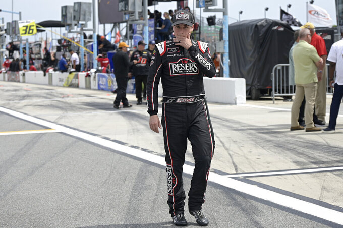 Driver Christopher Bell walks to his vehicle on pit road before a NASCAR Xfinity Series auto race at Daytona International Speedway, Saturday, Aug. 28, 2021, in Daytona Beach, Fla. (AP Photo/Phelan M. Ebenhack)