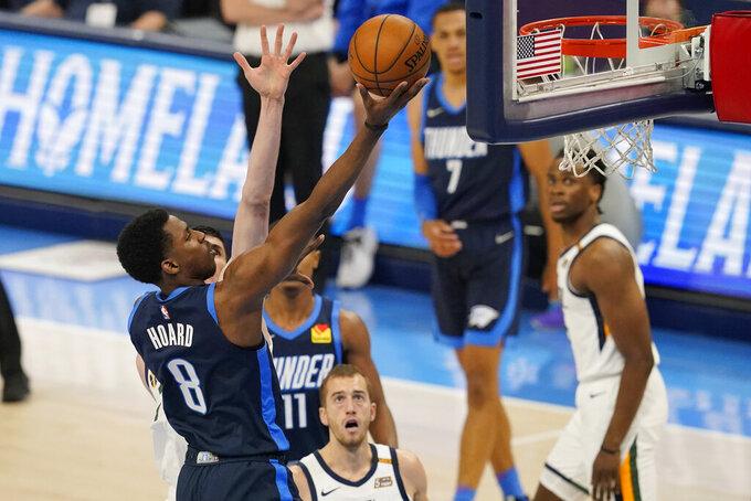 Oklahoma City Thunder forward Jaylen Hoard (8) shoots in front of Utah Jazz guard Matt Thomas, center, in the second half of an NBA basketball game Friday, May 14, 2021, in Oklahoma City. (AP Photo/Sue Ogrocki)