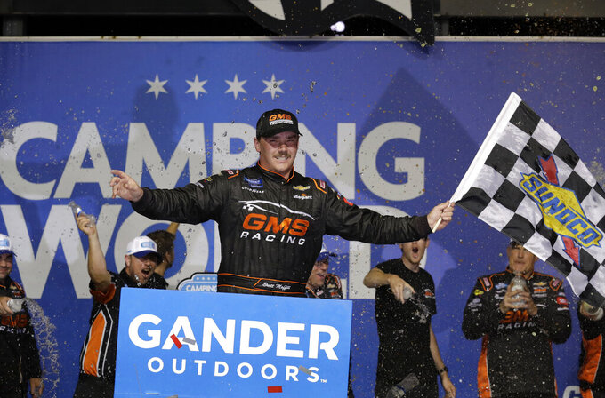 Brett Moffitt celebrates with his crew in Victory Lane after winning the NASCAR Truck Series auto race at Chicagoland Speedway in Joliet, Ill., Friday, June 28, 2019. (AP Photo/Nam Y. Huh)