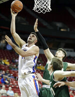 Colorado State's Nico Carvacho defends as Boise State's Zach Haney, left, shoots during the first half of an NCAA college basketball game in the Mountain West Conference tournament Wednesday, March 13, 2019, in Las Vegas. (AP Photo/Isaac Brekken)